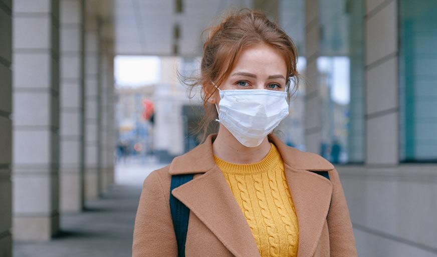 Woman wearing mask - corona virus - Emergency Locksmith 020 3808 7740